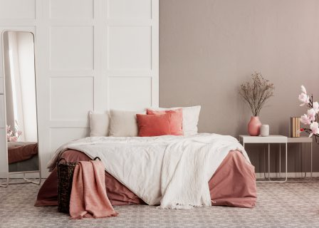 Orange,Pillows,On,White,King,Size,Bed,In,Fashionable,Female