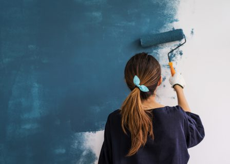 Young,Asian,Happy,Woman,Painting,Interior,Wall,With,Paint,Roller