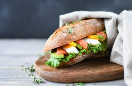 Sandwich,From,A,Cereal,Baguette,With,Avocado,,Salmon,,Egg,And